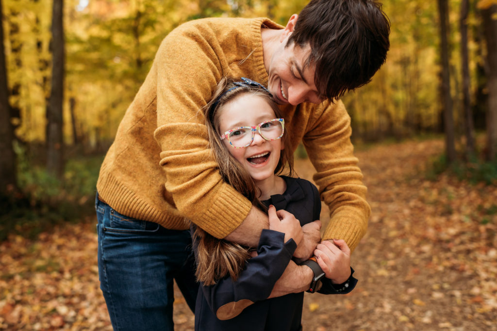 Family Photography, Dad hugging daughter in the forest
